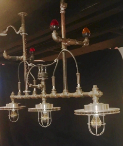 24V and 120V hanging black gas pipe pendant with marker lights and brake rotor.