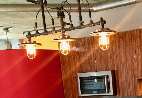 Custom created lighting by an electrical artist, these were made to fit in this space, but work equally well in it's next location