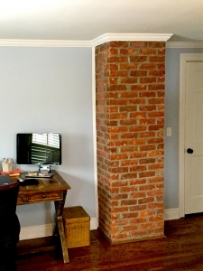 Quite literally, this brick that we exposed on this early 1900s Bloomfield colonial brings warmth to this master suite