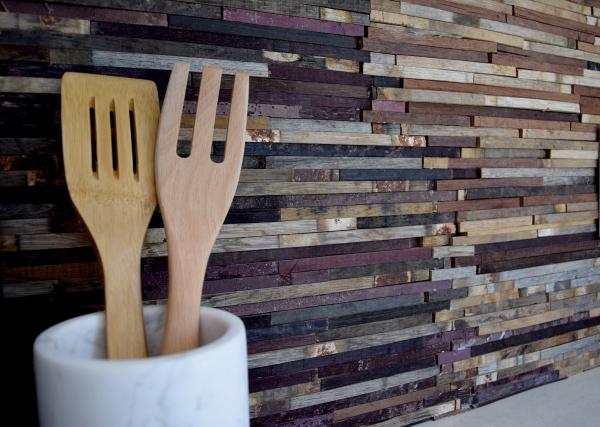 Custom backsplash with recycled wood remnants
