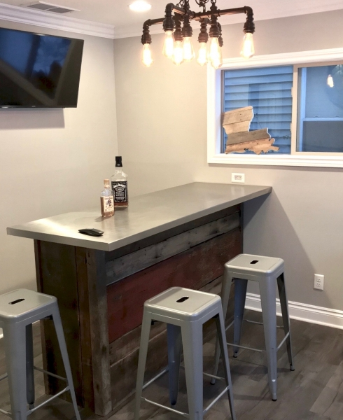 The aluminum top of the bar created the cool contrast to the warm reclaimed wood that it needed