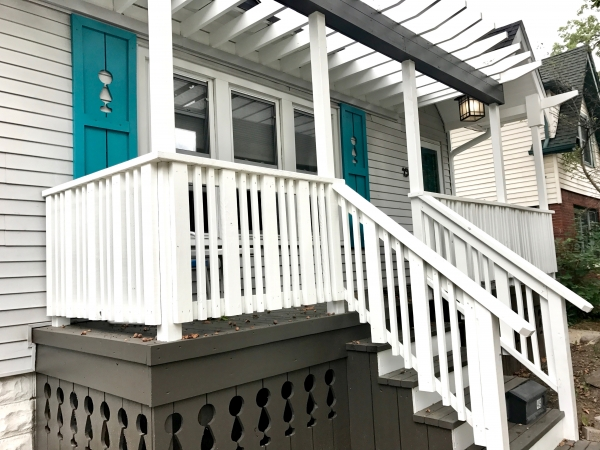 Custom crafted shutters and porch skirting for this front porch renovation - the open arbor was the perfect touch