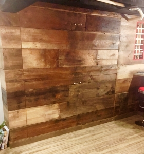 This transformed Fenton reclaimed cottage wood hides fully functional and convenient double Murphy beds