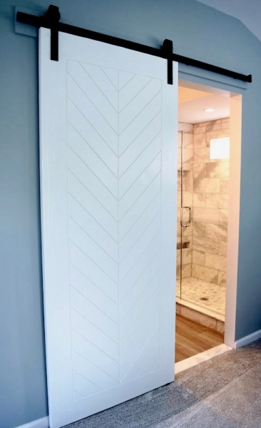 Custom-made bathroom sliding door with chevron print & matte black hardware