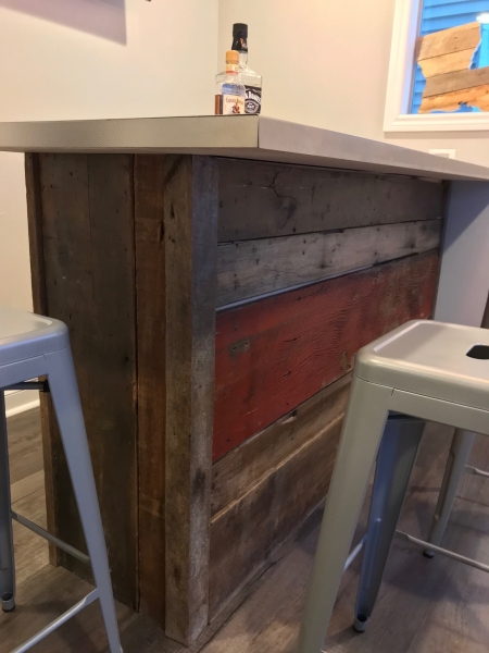 Reclaimed wood created the perfect bar for this very happy customer